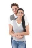 Pares novos felizes que abraçam-se Fotografia de Stock Royalty Free