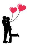 Pares novos no amor com corações Fotografia de Stock Royalty Free