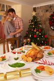 Pares novos no amor no Natal Fotos de Stock Royalty Free