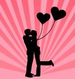 Pares novos no fundo do amor Fotos de Stock Royalty Free