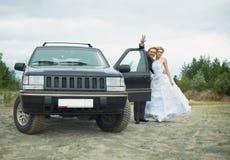 Pares nuevo-casados felices - luna de miel Fotografía de archivo