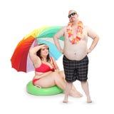 Pares obesos en la playa Imagen de archivo libre de regalías