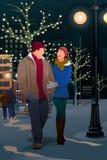 Pares que andam na rua em uma noite do inverno Fotografia de Stock Royalty Free