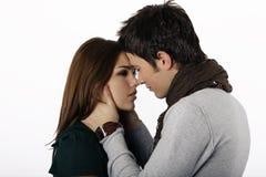 Pares que beijam quase fotografia de stock