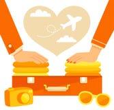 pares que embalam uma mala de viagem Imagens de Stock