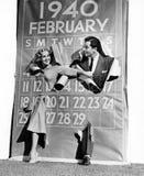 Pares que estallan a través de calendario del año bisiesto (todas las personas representadas no son vivas más largo y ningún esta Fotografía de archivo