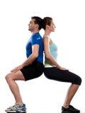 Pares que fazem o exercício de volta à parte traseira Fotografia de Stock Royalty Free