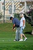 Pares que juegan al golf, Caleta de Velez fotografía de archivo