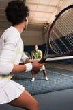 Pares que juegan a tenis Imagen de archivo libre de regalías
