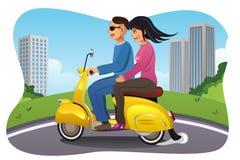 Pares que montam uma motocicleta Foto de Stock