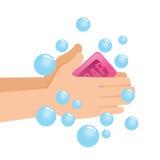 Pares que se lavan de mano con el jabón y las burbujas Imágenes de archivo libres de regalías