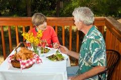 Pares que têm a refeição matinal Imagem de Stock