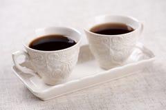 Pares retros bonitos de copos de café, com café Foto de Stock