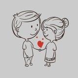Pares románticos con un corazón Imágenes de archivo libres de regalías