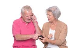 Pares superiores com smartphone imagem de stock royalty free
