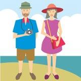 Pares turísticos con la cámara foto de archivo libre de regalías