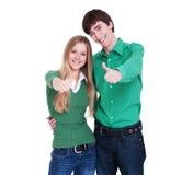Pares vívidos que mostram os polegares acima Foto de Stock Royalty Free