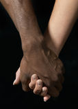 paret hands holdingbarn Arkivbild