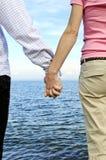 paret hands holdingen Arkivfoto