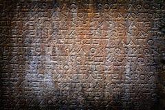 Parete antica di epigrafe di età immagine stock