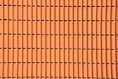 Parete arancio del cemento nella luce del giorno Fotografie Stock Libere da Diritti