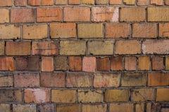 Parete arancio fatta dei mattoni Fotografie Stock