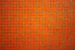 Parete arancione delle mattonelle Immagine Stock Libera da Diritti