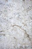 Parete bianca di lerciume con le crepe Fotografia Stock