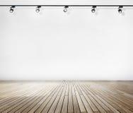 Parete bianca e pavimento di legno con i riflettori Immagini Stock