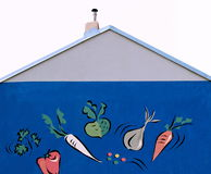 Parete blu con arte di verdure Fotografia Stock Libera da Diritti