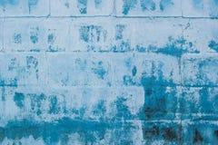 Parete blu o fondo blu del recinto Chiuda sul modello astratto del fondo del cemento strutturato Immagine Stock