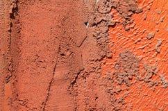 Parete con la pittura arancio variopinta del modello della pittura Fotografia Stock