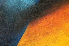 Parete con la pittura blu e gialla variopinta del modello della pittura Immagine Stock