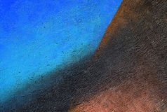 Parete con la pittura del modello della pittura murale di marrone blu immagini stock libere da diritti