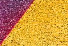 Parete con la pittura gialla variopinta del modello della pittura Fotografia Stock Libera da Diritti