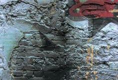 Parete con le tracce di graffiti Fotografia Stock