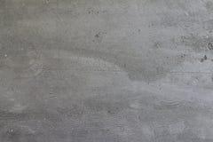 Parete concreta cruda grigia del cemento per gli ambiti di provenienza fotografia stock