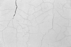 Parete concreta del cemento con il fondo del blu della crepa Fotografie Stock