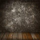 Parete concreta di lerciume e pavimento di legno Fotografia Stock Libera da Diritti