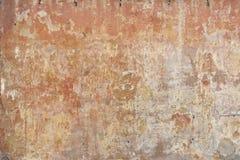 Parete consumata dello stucco nell'ocra e nelle terre coloranti Fotografie Stock