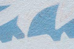 Parete del cemento con le forme blu Fotografia Stock