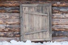 Parete del ceppo ed a porta chiusa di legno Immagine Stock