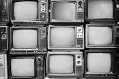 Parete del modello televisione in bianco e nero del mucchio di retro Fotografia Stock