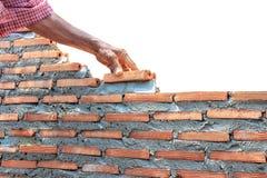 Parete della costruzione del muratore isolata sulla costruzione del whitebricklayer Immagini Stock
