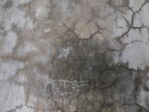 Parete della crepa, vecchio fondo grigio rotto di struttura del cemento Fotografia Stock Libera da Diritti