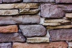 Parete della decorazione con le pietre fotografia stock