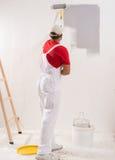 Parete della pittura con il rullo fotografia stock