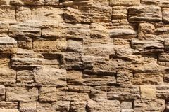 Parete delle pietre, fondo sotto forma di parete immagine stock libera da diritti