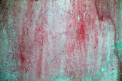 Parete di Grunge con la vernice di colore rosso della sbucciatura fotografia stock libera da diritti