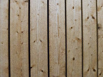 Parete di legno non-spianata dorata Fotografia Stock